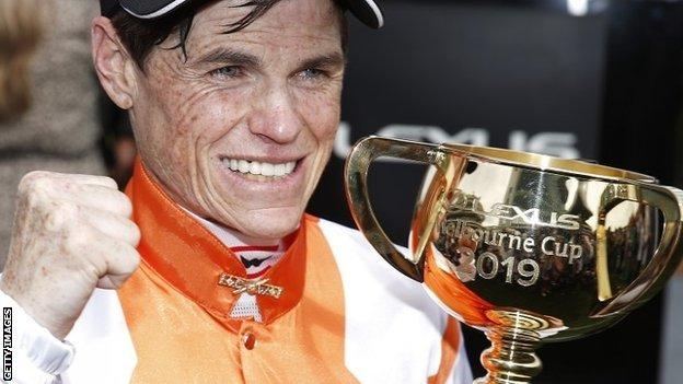 Jockey Craig Williams celebrates after his first Melbourne Cup victory