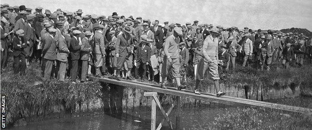 Macdonald Smith crosses the burn at Prestwick Golf Club in Scotland, during the Open Golf Championship , 26th June 1925