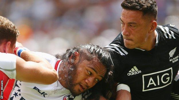 Thretton Palamo, of United States, tangles with New Zealand's Sonny Bill Williams at the 2016 Sydney Sevens