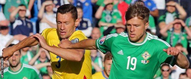 Jamie Ward (right) in action for Northern Ireland