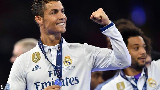 Cristiano Ronaldo celebrates winning the Champions League
