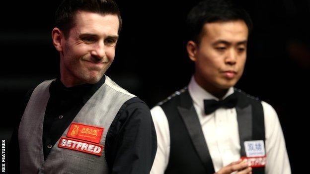 Mark Selby (left) and Marco Fu
