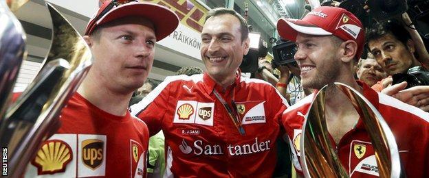 Sebastian Vettel and Kimi Raikkonen celebrate finishing first and third at the Singapore Grand Prix