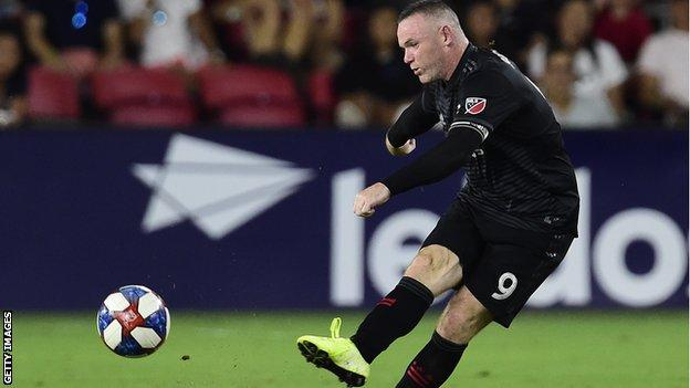 Wayne Rooney takes a shot during a DC United match