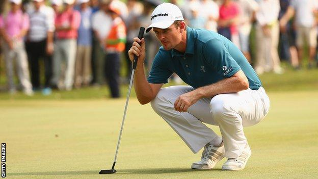 Justin Rose lines up a putt at the Hong Kong Open
