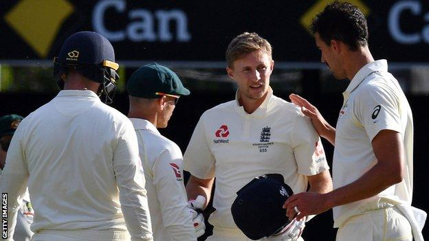 Australia's Mitchell Starc checks on Joe Root after hitting the England captain on the head with a bouncer