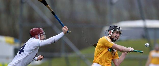 Kildare's Gerry Keegan attempts top block this shot from Saffrons opponent Jackson McGreevy