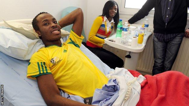 Togo's goalkeeper Kodjovi Obilale was one of those injured - pictured here with friends at Lorient hospital in France on 14 March 14, 2010