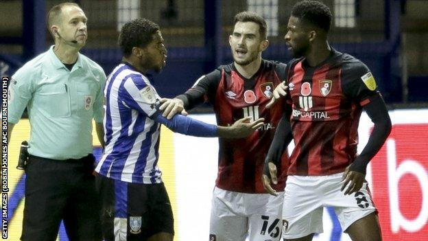 Sheffield Wednesday's Kadeem Harris (left) was sent off for a challenge on Jefferson Lerma (right) shortly after the alleged biting incident