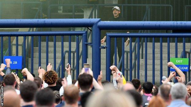 Kalvin Phillips celebrates promotion to the Premier League with Leeds fans at Elland Road