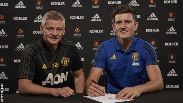 Harry Maguire pictured with Manchester United manager Ole Gunnar Solskjaer
