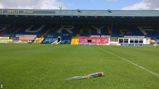 A rose was laid on the pitch at Gigg Lane by former director Joy Hart, the daughter of former Bury captain, coach and manager Les Hart, to symbolise the fan's love for the club