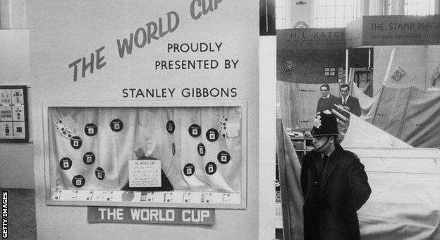 A policemen stands by a display case where the World Cup was stolen from