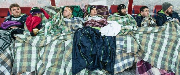 Connacht's replacements take protection from the freezing conditions in Siberia