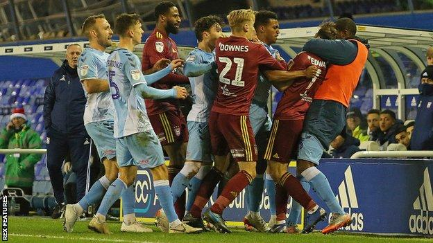 A melee during a match between Coventry City and Ipswich Town