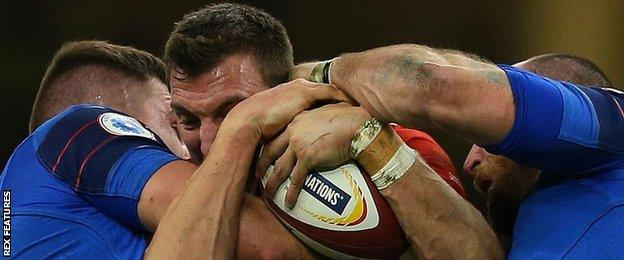 Wales captain Sam Warburton is held up against France