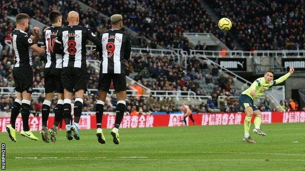 Harry Wilson takes a free kick for Bournemouth against Newcastle
