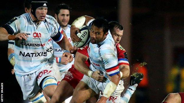 Casey Laulala is tackled by Scarlets' Gareth Davies