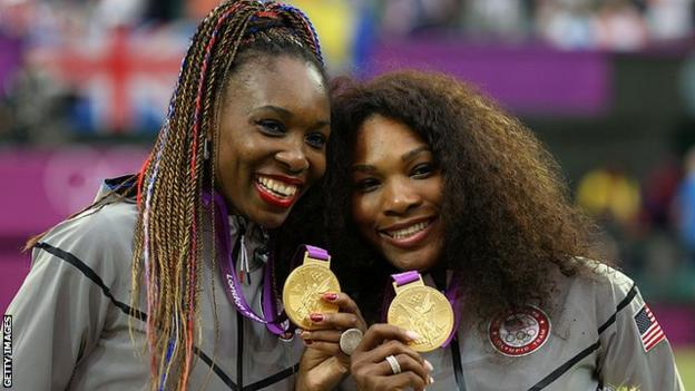 Venus Williams and Serena Williams celebrate winning gold at the Olympics in 2012
