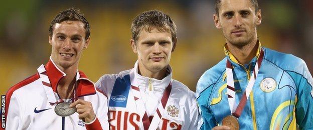 Britain's Paul Blake with Russian T36 400m gold medallist Yevgeny Shevetcov