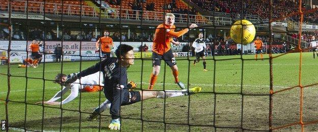 Simon Church's header beats Dundee United goalkeeper Eiji Kawashima