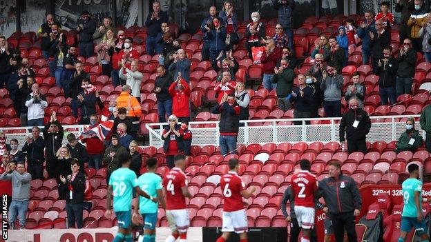 Middlesbrough fans applaud the players off the pitch after their Championship match against Bournemouth that saw 1,000 socially-distanced supporters attend