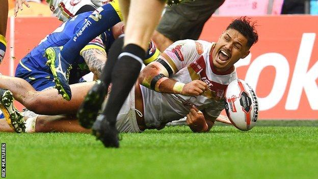 Brayden Wiliame of Catalan Dragons celebrates as he scores a try