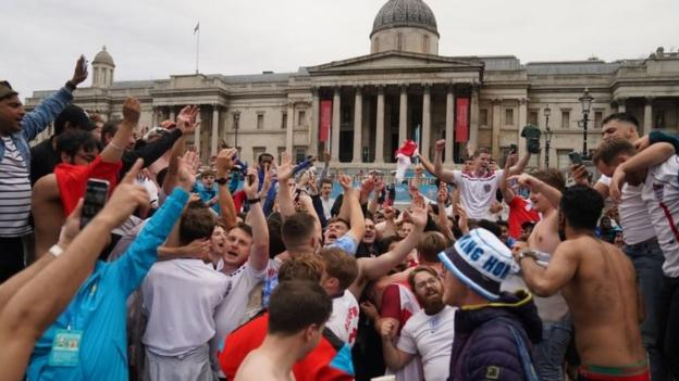 England fans celebrate after the UEFA Euro 2020 round of 16 match between England and Germany at the Trafalgar Square Fan Zone in London