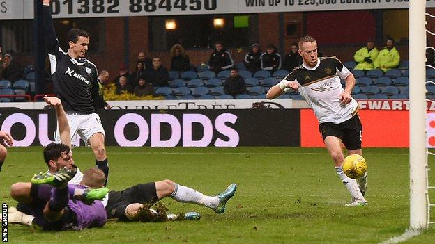 Adam Rooney knocks the ball in from close range