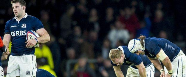 Scotland are disappointed after defeat by England at Twickenham