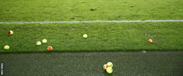 Tennis balls on the pitch at the Mercedes-Benz Arena
