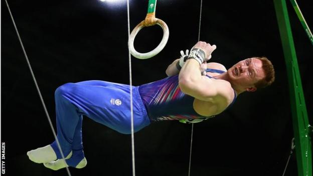 Dan Purvis competes on the rings at the Commonwealth Games