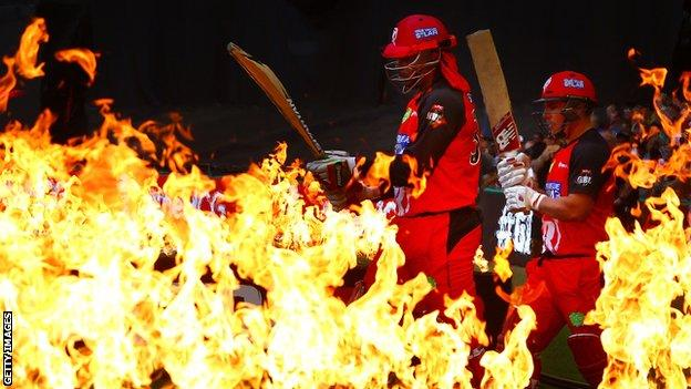 Chris Gayle and Aaron Finch walk out to bat