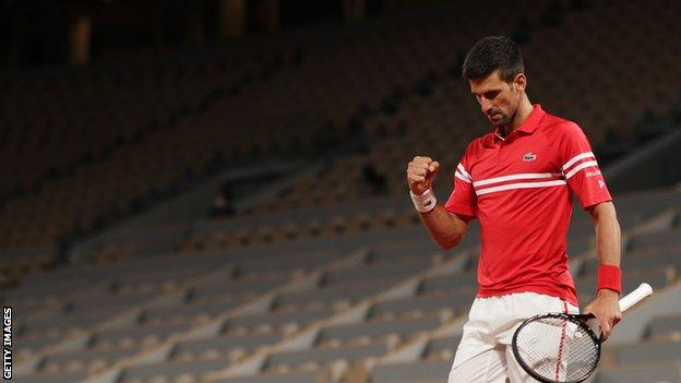 Novak Djokovic celebrates winning a point