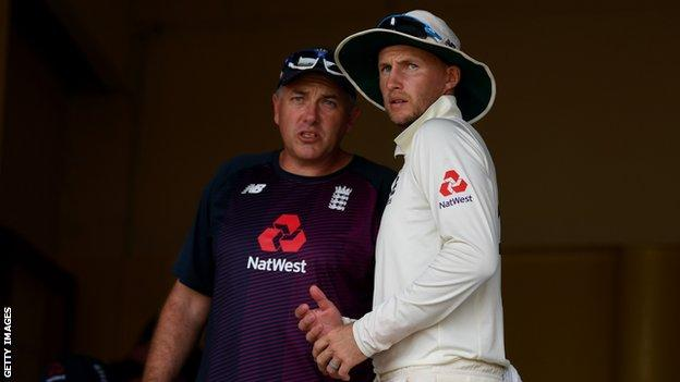 England captain Joe Root talks to head coach Chris Silverwood