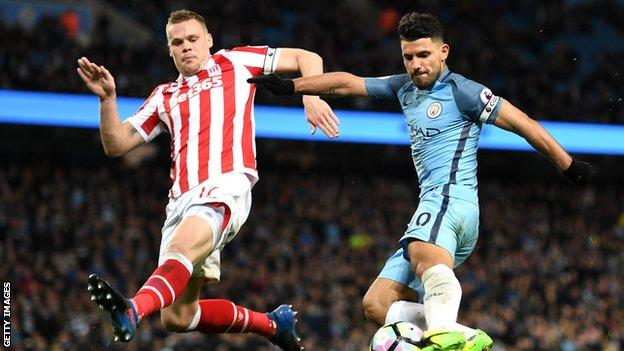 Ryan Shawcross and Sergio Aguero