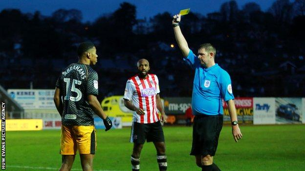 Newport sub Tristan Abrahams was one of eight players to be shown a yellow card by referee Brett Huxtable in a fiery encounter