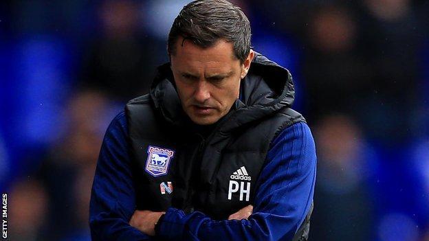 Ipswich boss Paul Hurst watches on