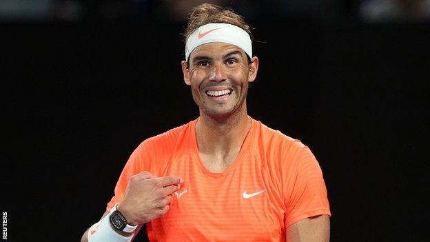 Rafael Nadal laughs during an exchange with a fan during his Australian Open second-round match
