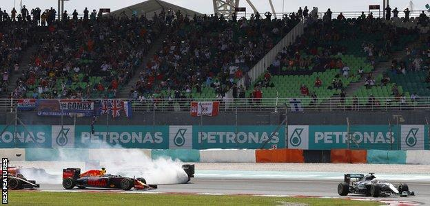 Nico Rosberg span at the first corner in Malaysia after being hit by Ferrari's Sebastian Vettel but recovered to finish third