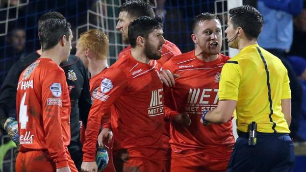 Portadown protest to referee Ian McNabb that Glenavon's late winner should have been disallowed for a foul on keeper David Miskelly