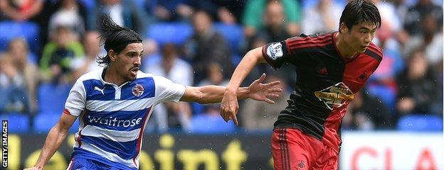 Ryan Edwards in action for Reading against Swansea's Ki-Sung-Yueng