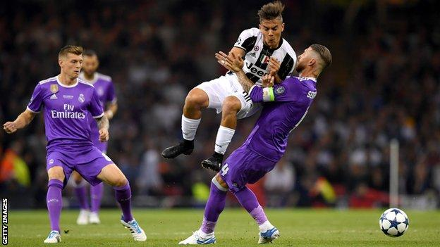 Paulo Dybala of Juventus and Sergio Ramos of Real Madrid