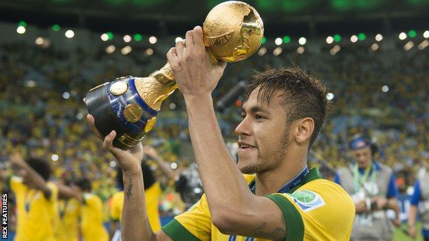 Neymar celebrates with the Confederations Cup trophy