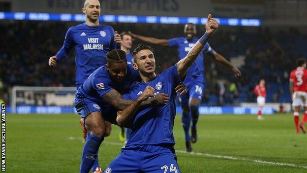 Marko Grujic celebrates scoring a goal with Kadeem Harris of Cardiff City in their 2-1 win over Barnsley.