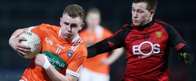 Armagh forward Jack Rafferty attempts to move clear of Down opponent Gareth McDowell