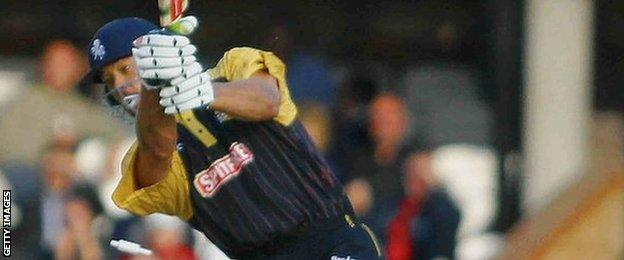 Andrew Symonds plays a cover drive