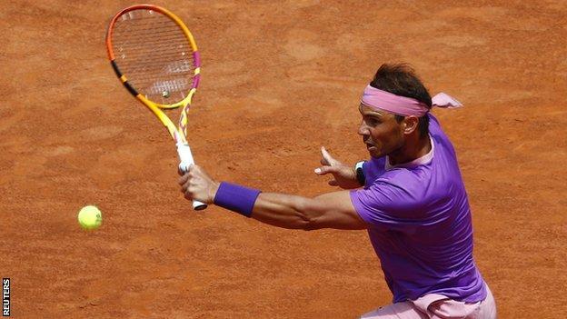 Rafael Nadal returns a ball against Alexander Zverev in their Italian Open quarter-final