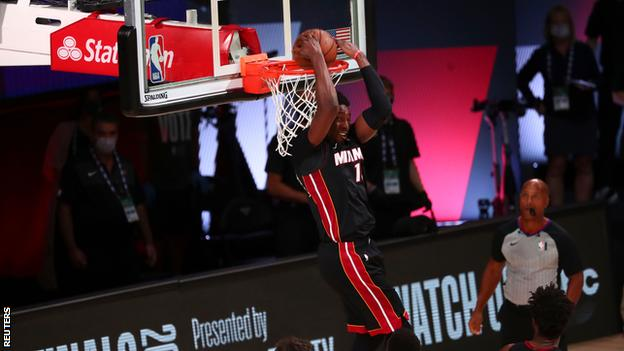 Bam Adebayo scores a dunk for the Miami Heat