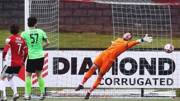 Harps keeper Mark McGinley can only watch James Akintunde's shot flying into the net